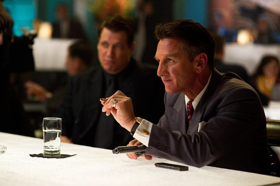 "This film image released by Warner Bros. Pictures shows Holt McCallany, left, as Karl Lockwood, and Sean Penn, as Mickey Cohen, in ""Gangster Squad."" (AP Photo/Warner Bros. Pictures, Wilson Webb)"
