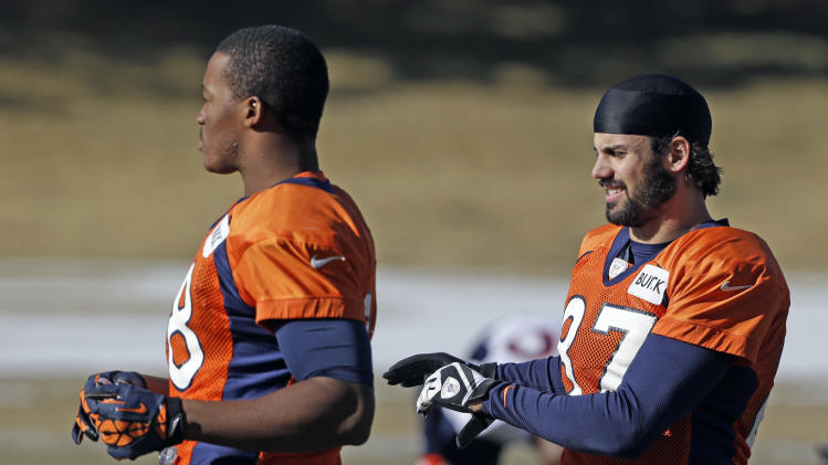 Denver Broncos wide receivers Demaryius Thomas and Eric Decker stretch at football practice at the team's training facility in Englewood, Colo., on Wednesday, Jan.9,  2013. The Broncos are scheduled to play the Baltimore Ravens in an NFL playoff game on Saturday. (AP Photo/Ed Andrieski)