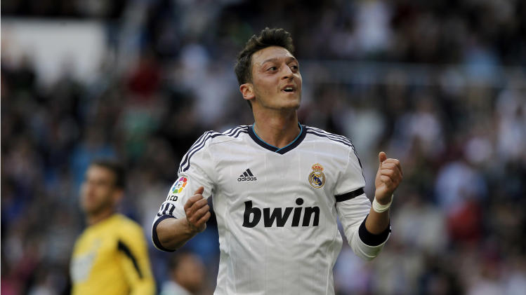 Real Madrid's Mesut Ozil from Germany celebrates his goal during a Spanish La Liga soccer match against Betis at the Santiago Bernabeu stadium in Madrid, Spain, Saturday, April 20, 2013. (AP Photo/Andres Kudacki)