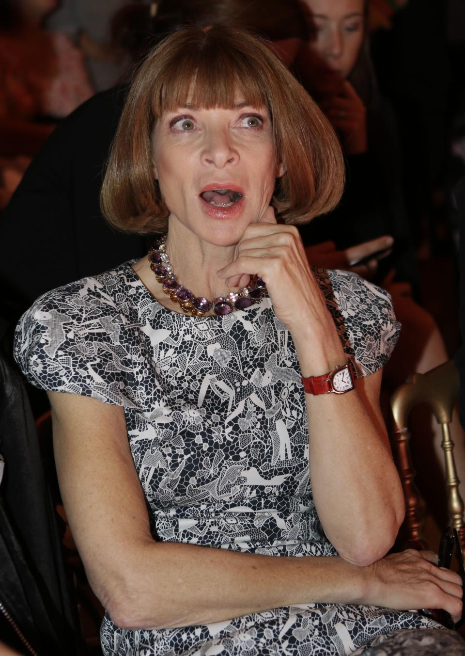 Vogue editor in chief Anna Wintour reacts as she attends the Versace women's Fall-Winter 2012-2013 collection that was presented in Milan, Italy, Friday Sept. 21, 2012.(AP Photo/Luca Bruno)