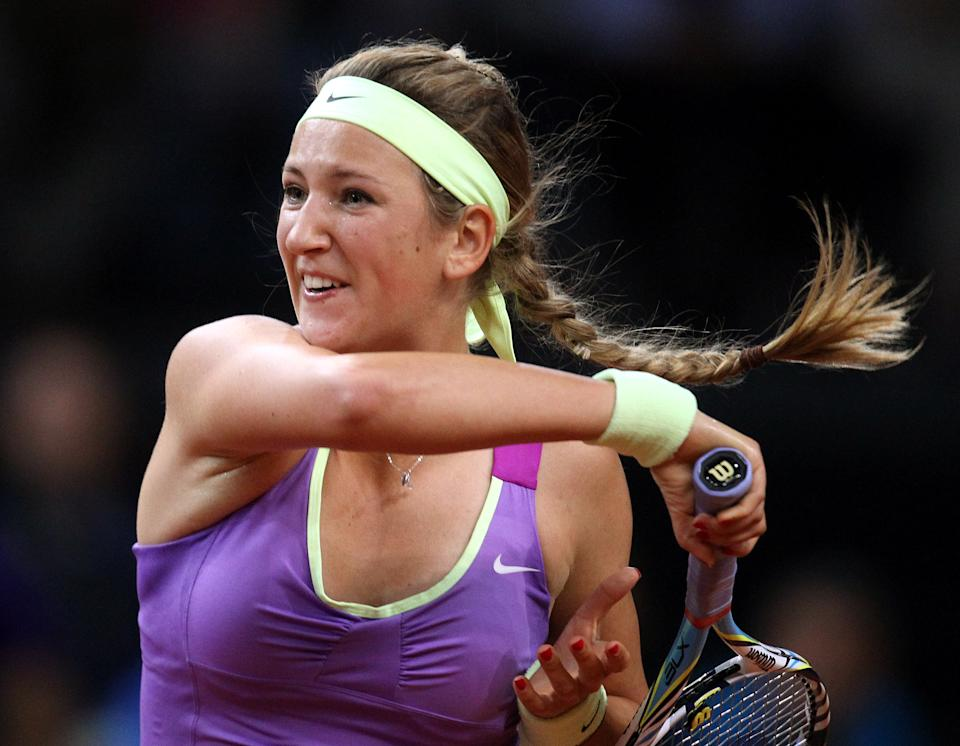 Belarus' Victoria Azarenka has hit a forehand against Poland's Agnieszka Radwanska during their semifinal match at the Porsche Tennis Grand Prix in Stuttgart, Germany, Saturday, April 28, 2012. Azarenka won 6-1 and 6-3 to reach Sunday's final. (AP Photo/Michael Probst)