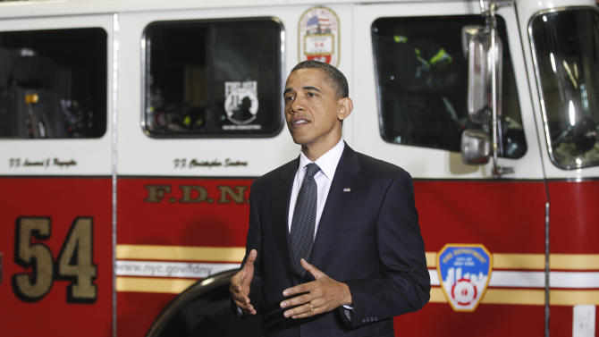 President Barack Obama speaks to firefighters and first responders at Engine 54, Ladder 4, Battalion 9 before visiting the National Sept. 11 Memorial at Ground Zero in New York, Thursday, May 5, 2011. (AP Photo/Charles Dharapak)