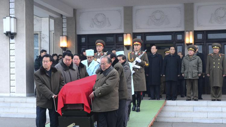 Pallbearers move the coffin of Kim Kuk Thae, chairman of the Control Commission of the ruling Workers' Party, during his state funeral