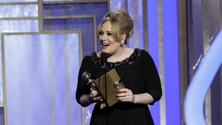 """This image released by NBC shows singer Adele, winner of the award for best original song for """"Skyfall"""" on stage during the 70th Annual Golden Globe Awards at the Beverly Hilton Hotel on Jan. 13, 2013, in Beverly Hills, Calif. (AP Photo/NBC, Paul Drinkwater)"""