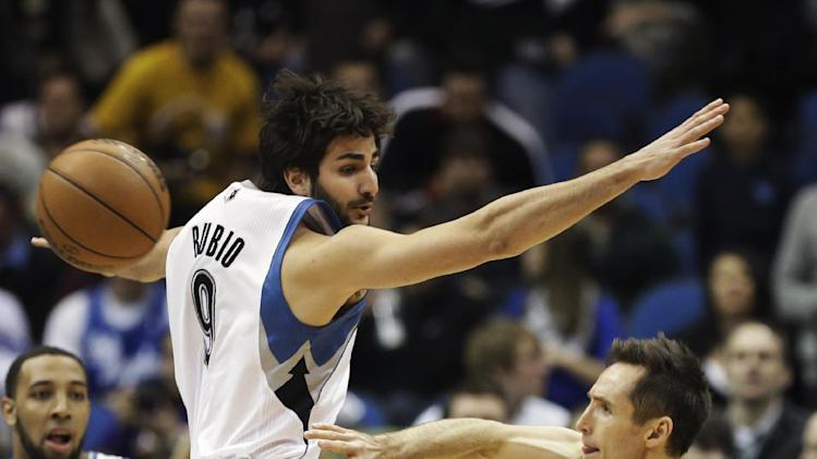 Minnesota Timberwolves' Ricky Rubio, left, of Spain, goes high to defend but Los Angeles Lakers' Steve Nash gets off a pass in the first quarter of an NBA basketball game, Friday, Feb. 1, 2013, in Minneapolis. (AP Photo/Jim Mone)