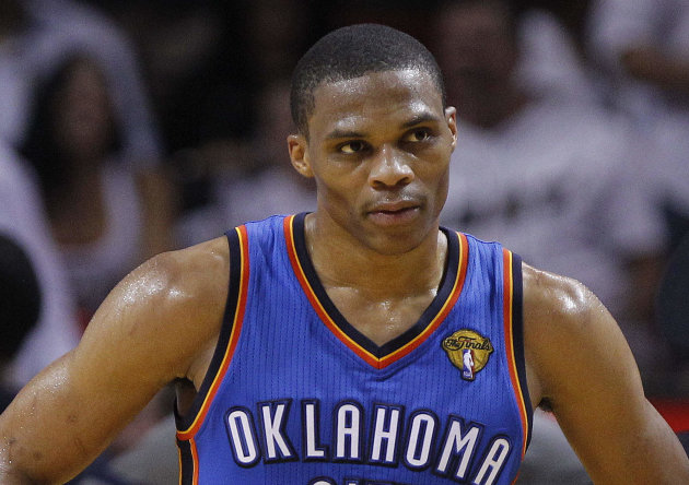 Oklahoma City Thunder point guard Russell Westbrook pauses between plays against the Miami Heat during the second half at Game 5 of the NBA finals basketball series, Thursday, June 21, 2012, in Miami. (AP Photo/Lynne Sladky)
