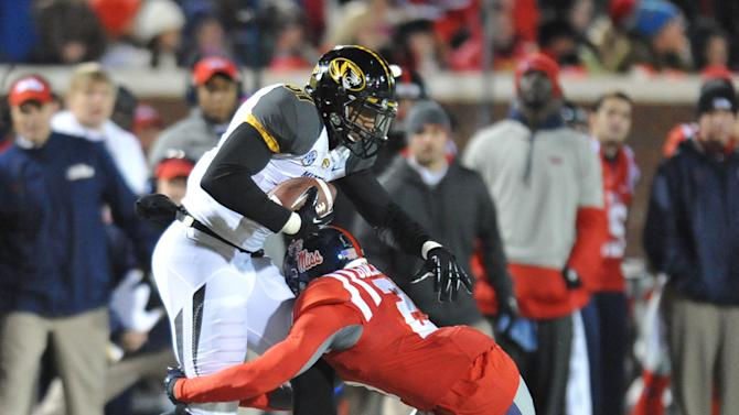Missouri's Eric Waters (81) is tackled by Mississippi defensive back Senquez Golson (21) at Vaught-Hemingway Stadium in Oxford, Miss. on Saturday, November 23, 2013. Missouri won 24-10