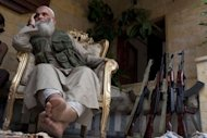 A rebel fighter rests at a courtyard in the Old City front line in Aleppo, northern Syria, on September 18, 2013