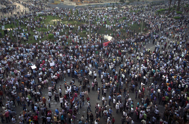 Protesters gather in Tahrir square in Cairo, Egypt, Friday, Oct. 12, 2012. Thousands of supporters and opponents of Egypt&#39;s new Islamist president clashed in Cairo&#39;s Tahrir Square on Friday, hurling stones and concrete and swinging sticks at each other in the first such violence since Mohammed Morsi took office more than three months ago.(AP Photo/Khalil Hamra)