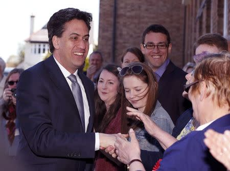 Britain's Labour Party leader Ed Miliband is greeted by supporters as he arrives at a campaign event in Pensby northern England