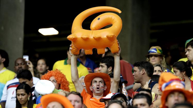 The Netherlands fans cheer before  the World Cup quarterfinal soccer match between the Netherlands and Costa Rica at the Arena Fonte Nova in Salvador, Brazil, Saturday, July 5, 2014