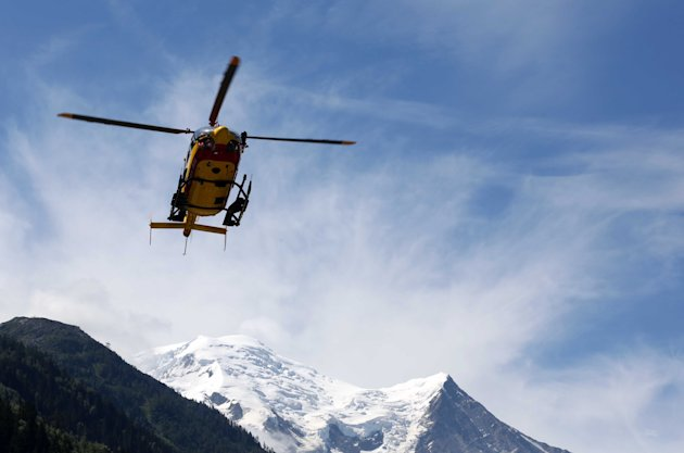 A rescue worker helicopter returning from the avalanche site, lands in Chamonix, French Alps, Thursday, July, 12, 2012. An avalanche in the French Alps swept six European climbers to their deaths on a slope leading to Mont Blanc, and left at least nine others injured and several climbers unaccounted for, authorities said. Two climbers were rescued and emergency crews are searching for the missing. A group of 28 climbers from Switzerland, Germany, Spain, France, Denmark and Serbia are believed to be in the expedition caught in the avalanche that was about 4,000 meters (13,1000 feet) high on the north face of Mont Maudit, part of the Mont Blanc range. (AP Photo)