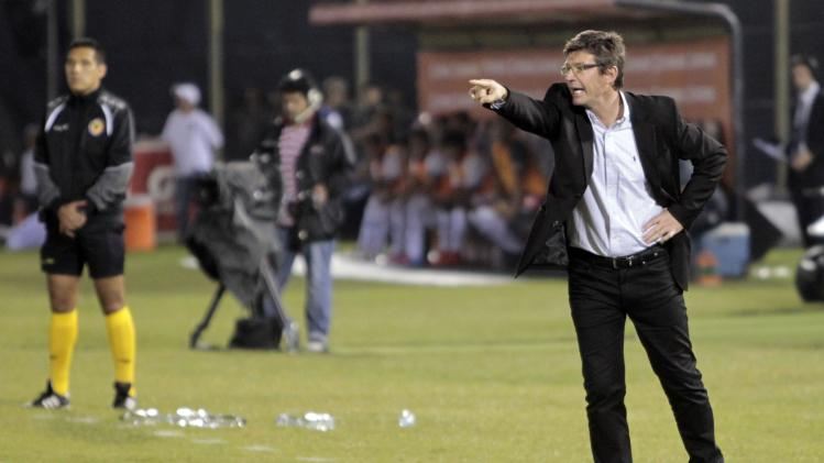 Uruguay's Defensor Sporting coach Curutchet gestures during their Copa Libertadores semi-final soccer match against Paraguay's Nacional in Asuncion