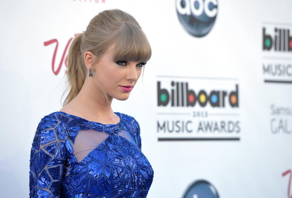Taylor Swift arrives at the Billboard Music Awards at the MGM Grand Garden Arena on Sunday, May 19, 2013 in Las Vegas. (Photo by John Shearer/Invision/AP)