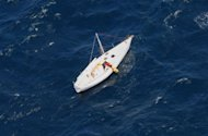 A yacht carrying Australian yachtsman Glenn Ey drifting in a remote area of the ocean off Australia's eastern coast. Glenn Ey, 44, spent days adrift before being spotted by an Air Canada passenger plane, which swooped down low to search for him after being diverted by Australian authorities en route to Sydney from Vancouver