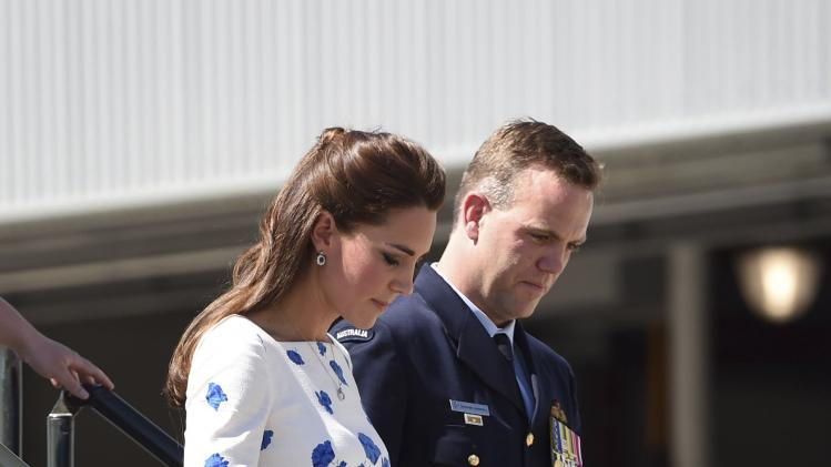 Catherine, Duchess of Cambridge walks from a RAAF Super Hornet of 1 Squadron at RAAF Base Amberley near Brisbane