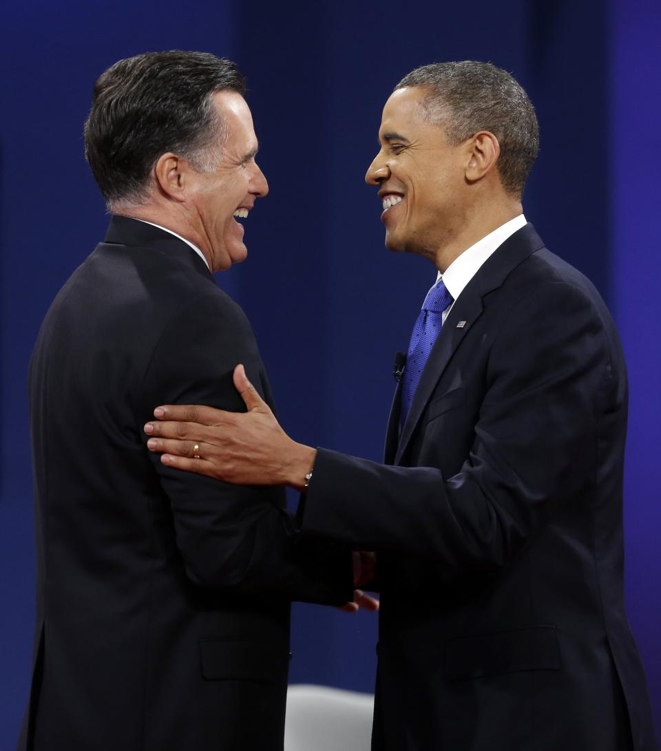 Republican presidential candidate, former Massachusetts Gov. Mitt Romney and President Barack Obama shake hands at the end of the last debate at Lynn University, Monday, Oct. 22, 2012, in Boca Raton, Fla. (AP Photo/Pablo Martinez Monsivais)