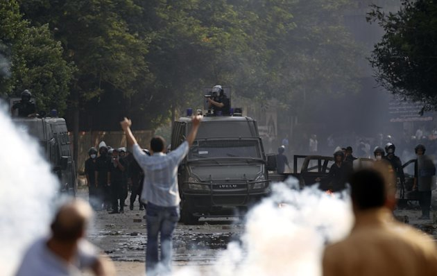 Egyptian protesters clash with riot police near the U.S. embassy in Cairo, Egypt, Thursday, Sept. 13, 2012. Protesters clashed with police near the U.S. Embassy in Cairo for the third day in a row. Egypt's Islamist President Mohammed Morsi vowed to protect foreign embassies in Cairo, where police were using tear gas to disperse protesters at the U.S. mission. (AP Photo/Khalil Hamra)