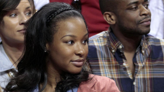 Savannah Brinson watches her fiance Miami Heat's LeBron James during an NBA basketball game against the Charlotte Bobcats in Miami, Sunday, Jan. 1, 2012. (AP Photo/Alan Diaz)
