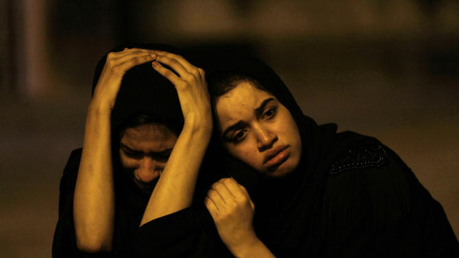 "Bahraini women sit on the street and mourn a youth killed during an anti-government protest, allegedly by police shotgun fire, in the western village of Sadad, Bahrain, early Saturday, Sept. 29, 2012. An Interior Ministry statement said a police patrol was attacked with petrol bombs and iron rods, and one person died when ""policemen defended themselves."" A witness among protesters said demonstrators were marching against the government when a policeman suddenly stepped out near the youth and shot him at close range. (AP Photo/Hasan Jamali)"