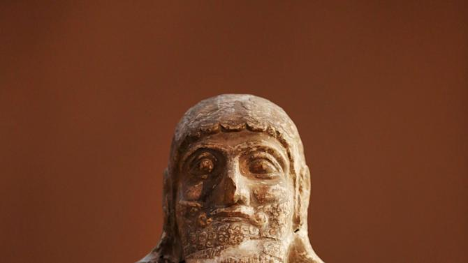 This Monday, Sept. 15, 2014 photo shows, a stone statue displayed at the Iraqi National Museum in Baghdad. The Islamic State militants seek to purge society of all influences that don't conform with their strict, puritanical version of Islam. That means destroying not only relics seen as pagan but also Muslim sites they see as contradicting their ideology, particularly Sunni Muslim shrines they see as idolatrous as well as mosques used by Shiites, a branch of Islam they consider heretical. (AP Photo/Hadi Mizban)