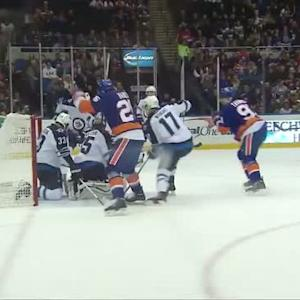 Dustin Byfuglien helps save a goal