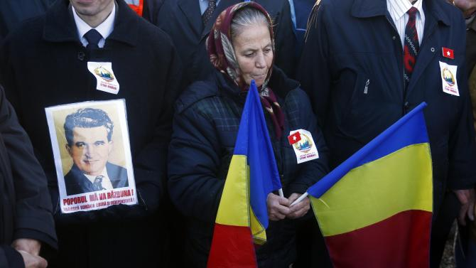 People attend a commemoration ceremony at the grave of Romania's late Communist dictator Ceausescu in a Bucharest cemetery