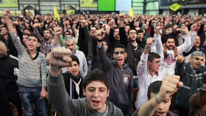 "Hezbollah supporters cheer as they listen to a speech by Hezbollah leader Hassan Nasrallah, during a ceremony to mark Islam's Prophet Muhammad's birth in the southern suburbs of Beirut, Lebanon, Friday, Jan. 25, 2013. Nasrallah, a staunch ally of the Syrian regime, said those who had dreamed about ""dramatic changes"" taking place in Syria should let go of their dreams. He said all military, political and international indications showed that President Bashar Assad's regime cannot be defeated. (AP Photo/Bilal Hussein)"