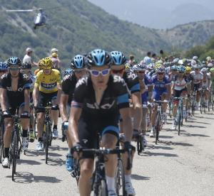 The pack with Christopher Froome of Britain, wearing the overall leader's yellow jersey, rides during the sixteenth stage of the Tour de France cycling race over 168 kilometers (105 miles) with start in in Vaison-la-Romaine and finish in Gap, France, Tuesday July 16, 2013. (AP Photo/Laurent Cipriani)