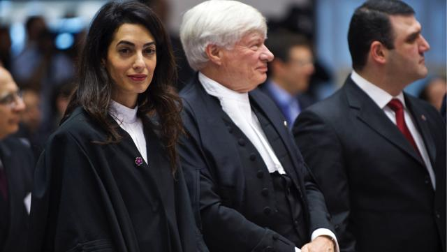 A Stylish Amal Clooney Goes Back to Work, Rebuffs Fashion Question
