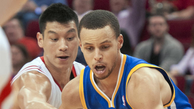 Houston Rockets' Jeremy Lin, left, defends against Golden State Warriors' Stephen Curry (30) during the first quarter of an NBA basketball game, Tuesday, Feb. 5, 2013, in Houston. (AP Photo/Dave Einsel)
