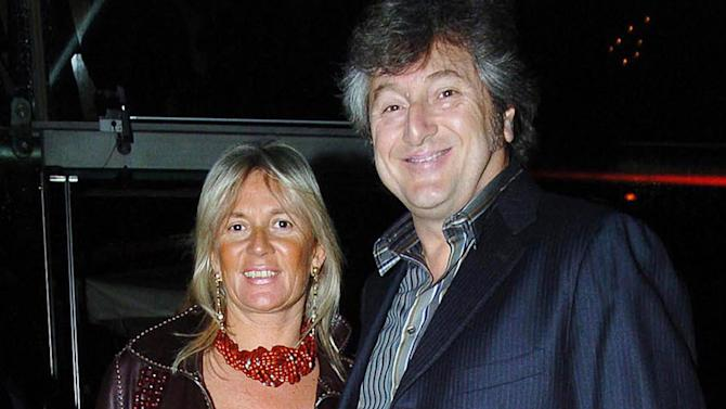 In this photo taken on March 30, 2005 Vittorio Missoni, right, and his wife Maurizia Castiglioni smile in Milan, Italy. The search resumed Saturday, Jan. 5, 2013 for a small plane that has disappeared off the Venezuelan coast with six people aboard, including Vittorio Missoni, a top executive in Italy's Missoni fashion house, officials said. Vittorio Missoni, 58, is the director general of the iconic brand and the eldest son of the company's founder. Flying with him on Friday's flight from Venezuela's Los Roques resort archipelago to Caracas, was Missoni's wife, Maurizia Castiglioni, two Italian friends of the couple, and a crew of two Venezuelans. (AP Photo/Livio Valerio, Lapresse)