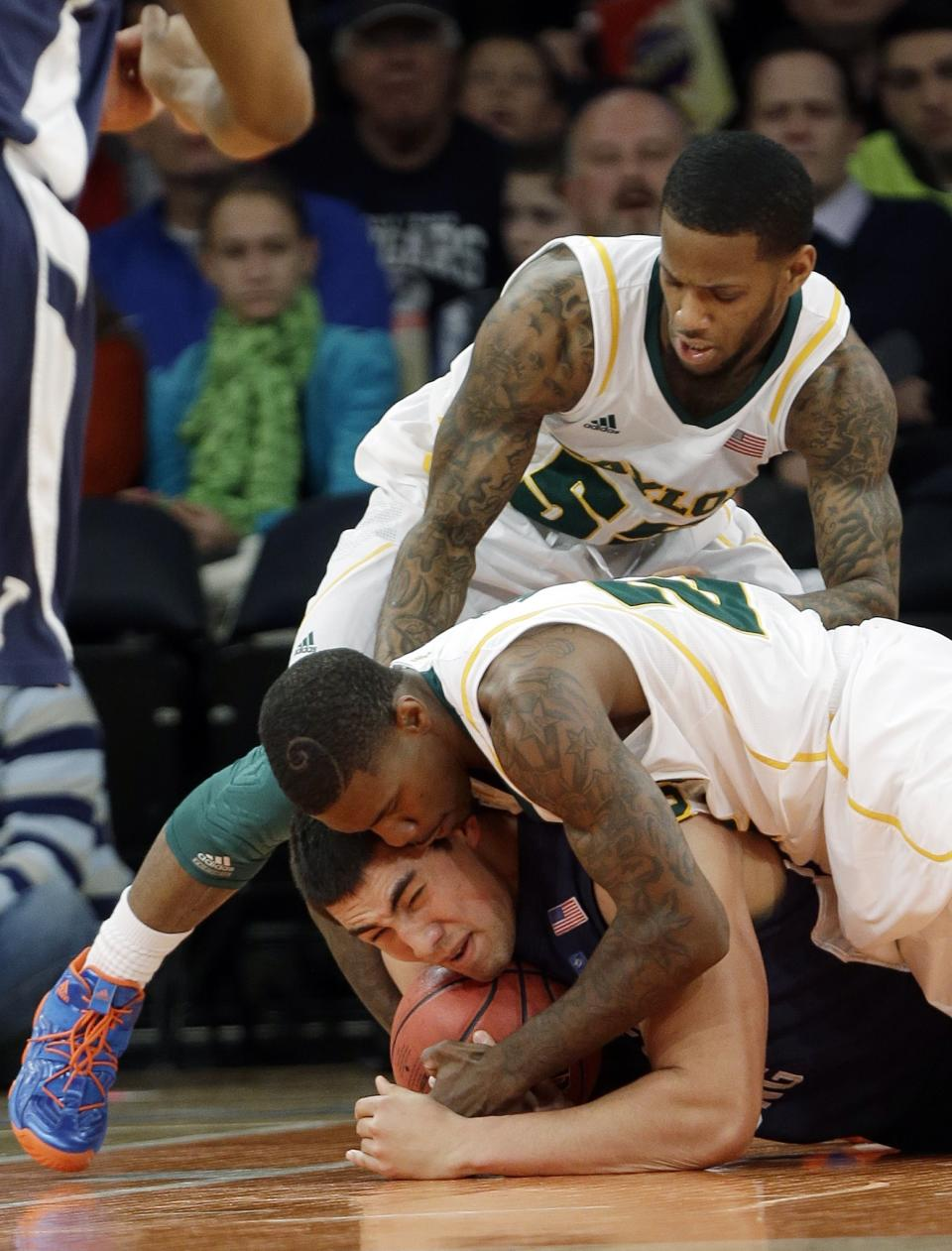 Baylor's Pierre Jackson (55) and A.J. Walton (22) fight for control of the ball with Brigham Young's Bronson Kaufusi, during the first half of an NIT semifinal basketball game Tuesday, April 2, 2013, in New York. (AP Photo/Frank Franklin)