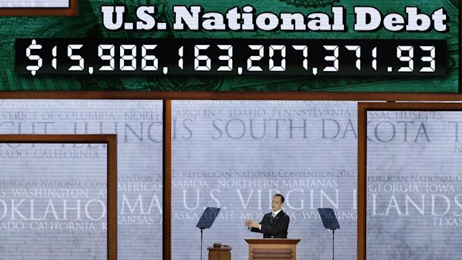 FILE This Aug. 27, 2012 file photo shows Republican National Committee (RNC) Chairman Reince Priebus announces the display of the debt ticker during the Republican National Convention in Tampa, Fla. You wouldn't know it from listening to the Republican National Convention, but the nation's economic picture seems to be slowly getting a little brighter. Not a lot, and not very fast. Yet there are some glimmers. But a steady drumbeat of gloom and doom is predictably being sounded at the GOP gathering in Tampa, Fla. _ even by GOP governors quick to tout economic improvements in their own states. (AP Photo/J. Scott Applewhite, File)