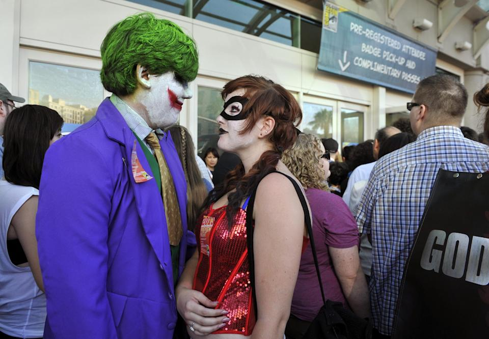 Ernesto Solis, left, and Michelle Repinski, both of San Diego, Calif, wait to get admitted to the Preview Night event on Day 1 of the 2013 Comic-Con International Convention on Wednesday, July 17, 2013 in San Diego, Calif. (Photo by Chris Pizzello/Invision/AP)