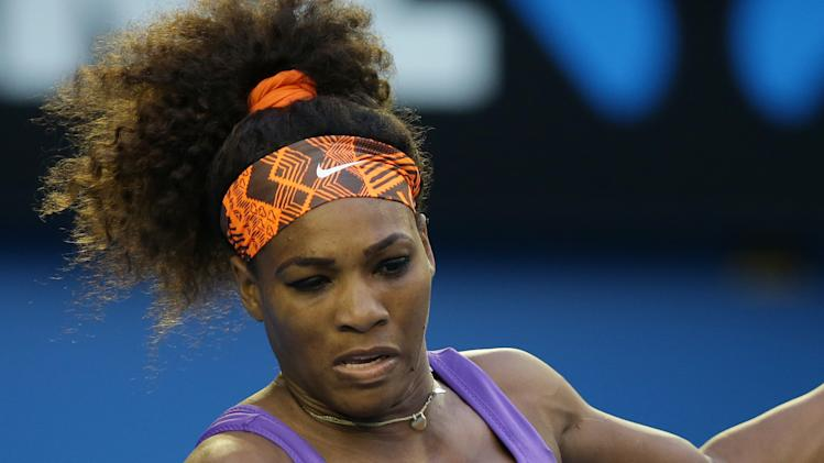 Serena Williams of the US hits a forehand return to Russia's Maria Kirilenko during their fourth round match at the Australian Open tennis championship in Melbourne, Australia, Monday, Jan. 21, 2013. (AP Photo/Dita Alangkara)