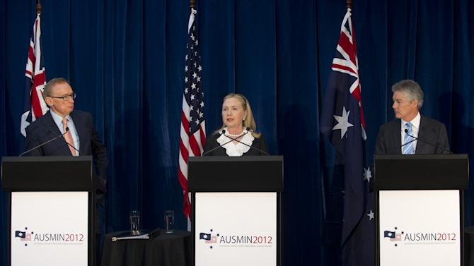 U.S. Secretary of State Hillary Rodham Clinton, center, speaks as Australian Foreign Minister Bob Carr, left, and Australian Minister of Defense Stephen Smith look on during a press conference following meetings as part of AUSMIN, or Australia-United States Ministerial Consultation, at the State Reception Centre in Kings Park in Perth, Australia, Wednesday, Nov. 14, 2012. (AP Photo/Saul Loeb, Pool)