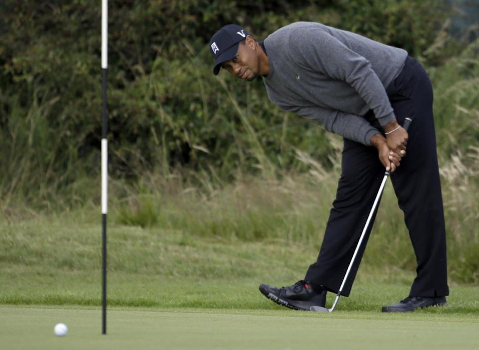Tiger Woods of the United States looks at his chip shot on the 14th green at Royal Lytham & St Annes golf club during the second round of the British Open Golf Championship, Lytham St Annes, England, Friday, July 20, 2012. (AP Photo/Chris Carlson)