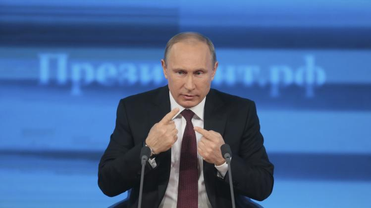 Russian President Putin takes part in a televised news conference in Moscow