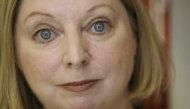 FILE - The Booker Prize winning author Hilary Mantel poses for a photograph in London in this file photo dated Thursday, Oct. 8, 2009. Mantel is widely criticized in the media Tuesday Feb. 19, 2013, for her &quot;venomous attack&quot; on the former Kate Middleton, the wife of Prince William, for published comments about the British publics complex relationship with royalty quoting Mantel saying the princess is &quot;a jointed doll on which certain rags were hung&quot;, and said she appeared to be designed by committee with a perfect plastic smile. (AP Photo/Alastair Grant, File)