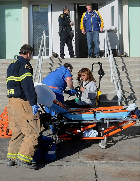 This image provided by the Taft Midway Driller/Doug Keeler shows paramedics assisting a student wounded during a shooting Thursday Jan. 10, 2013 at San Joaquin Valley high school in Taft, Calif. Autho