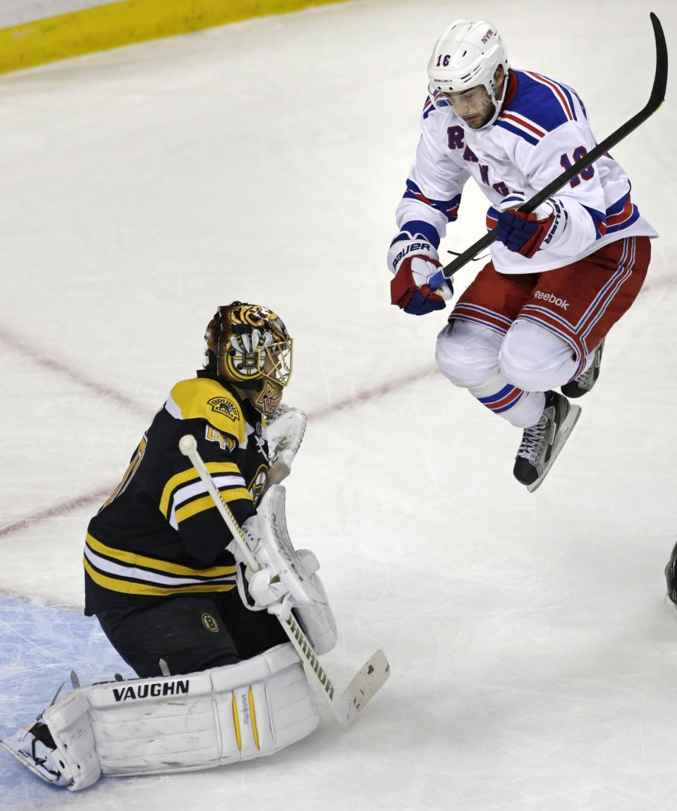 New York Rangers center Derick Brassard (16) jumps out of the way of a teammate's shot as Boston Bruins goalie Tuukka Rask, left, makes a save during the first period in Game 1 of an NHL hockey playoffs Eastern Conference semifinal game in Boston, Thursday, May 16, 2013. (AP Photo/Charles Krupa)