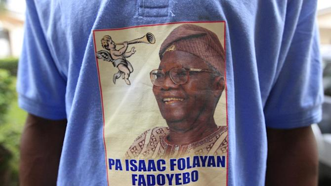"A shirt bearing the image of the late Isaac Fadoyebo is seen on a man at the ceremony honoring the late World War II combatant in Lagos, Nigeria, on Thursday, Jan. 24, 2013. Fadoyebo, who died in November at the age of 86, represents one of the last so-called ""Burma Boys"" still living through West and East Africa. On Thursday, his family and friends gathered for a final worship service and celebration of his life, as new attention has been paid to his sacrifices and those of other Africans drawn into the fighting. (AP Photo/Jon Gambrell)"