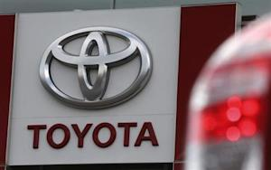 A sign with a logo is on display at a Toyota car sales and sho room in St. Petersburg