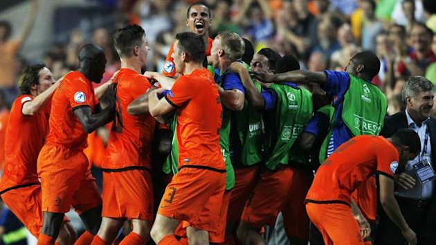 Netherland's Adam Maher (C) celebrates his team's goal against Germany with his teammates during their UEFA European Under-21 Championship soccer match against Germany at the HaMoshava stadium in Petah Tikva June 6, 2013. (Reuters)
