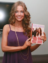 NEW YORK, NY - JULY 27:  Denise Richards poses for photos with her new book &quot;Real Girl Next Door&quot; during a taping of &quot;FOX & Friends&quot; at FOX Studios on July 27, 2011 in New York City.  (Photo by Astrid Stawiarz/Getty Images)