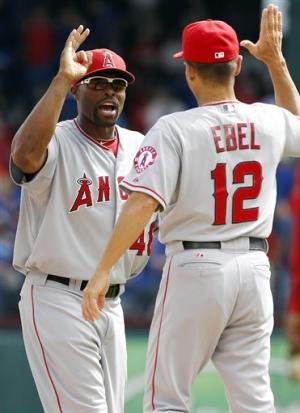 Rangers earn split with Angels to get playoff spot