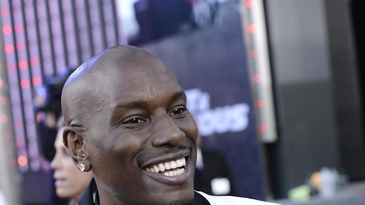 "Actor and singer Tyrese Gibson arrives at the LA Premiere of the ""Fast & Furious 6"" at the Gibson Amphitheatre on Tuesday, May 21, 2013 in Universal City, Calif. (Photo by Dan Steinberg/Invision/AP)"