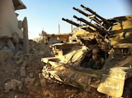 "A Syrian army soldier sits in his tank in the southwestern neighborhood of the Syrian city of Qusayr. France said Tuesday it has proof that President Bashar al-Assad's regime was using the deadly nerve agent sarin gas in Syria's civil war, adding ""all options,"" including armed intervention, were on the table"