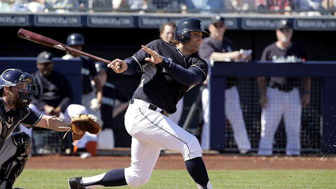 Seattle Mariners' Brad Miller bats during the second inning of a spring training baseball game against the San Diego Padres Thursday, March 5, 2015, in Peoria, Ariz. (AP Photo/Charlie Riedel)